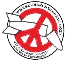 """Logo der Kampagne """"Atomwaffenfrei jetzt"""" aus dem roten Peace-Zeichen, in dem eine schwarz umrissene zerbrochene Atomrakete klemmt."""